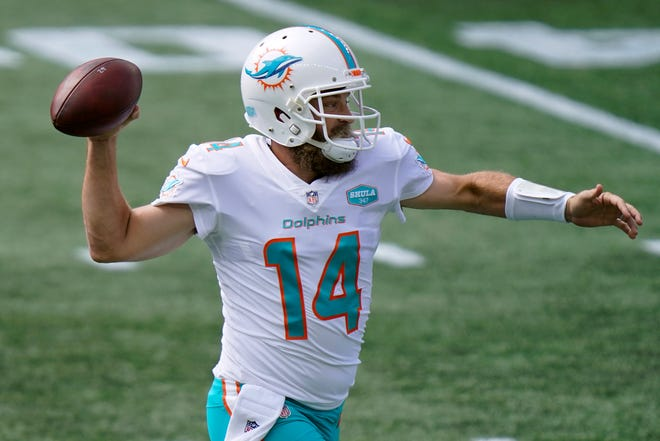 Dolphins quarterback Ryan Fitzpatrick was picked off three times Sunday by the Patriots.