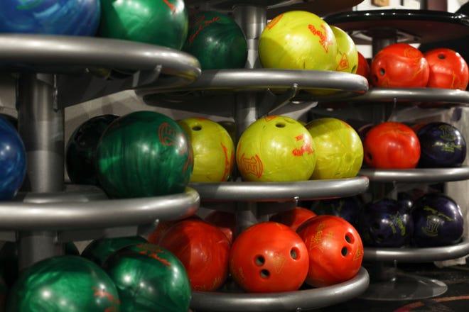Bowling balls are kept behind the counter at B&B Bowling Lanes.