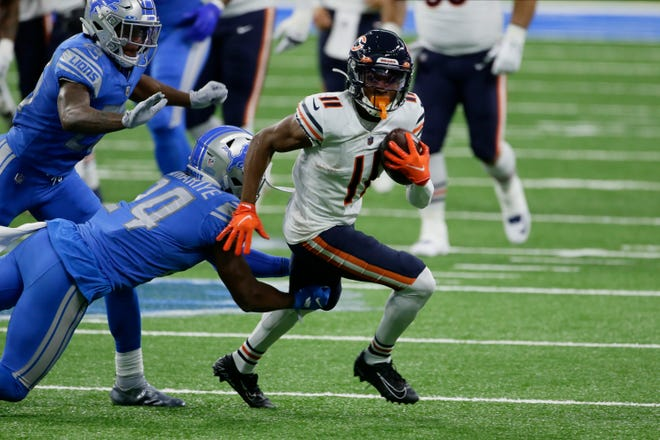 Chicago Bears wide receiver Darnell Mooney (11) runs after a catch against the Detroit Lions in the first half of an NFL football game in Detroit, Sunday, Sept. 13, 2020.