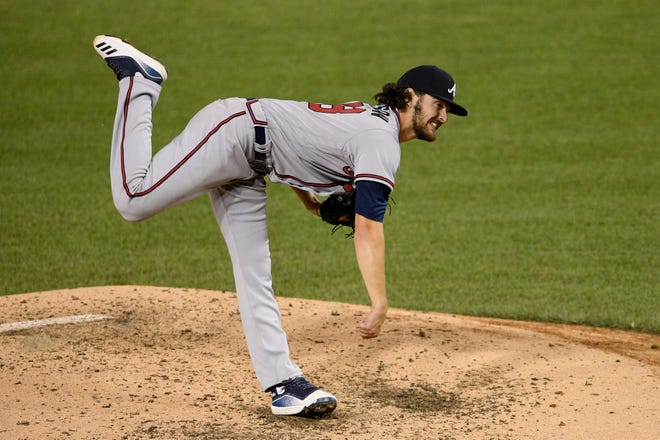 Atlanta's Ian Anderson follows through on a pitch during the fifth inning against Washington on Saturday.