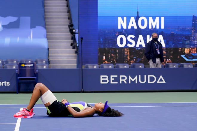 Naomi Osaka, of Japan, reacts after defeating Victoria Azarenka, of Belarus, in the women's singles final of the US Open tennis championships, Saturday, Sept. 12, 2020, in New York.