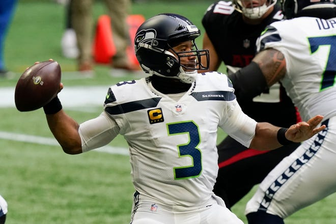 Seattle Seahawks quarterback Russell Wilson (3) works in the p[ocket against the Atlanta Falcons during the first half of an NFL football game, Sunday, Sept. 13, 2020, in Atlanta. (AP Photo/Brynn Anderson)