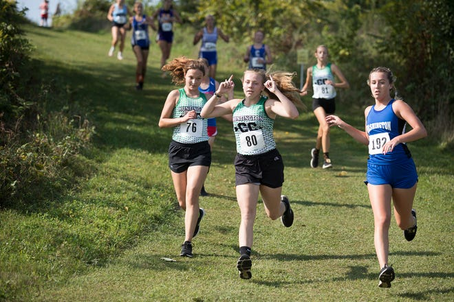 Huntington's Kacie Carr competes in the Zane Trace Invitational earlier this season. Running has helped Carr beat her anxiety and find peace.