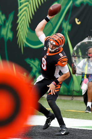 Cincinnati Bengals quarterback Joe Burrow (9) spikes the ball after running in his first career touchdown in the first quarter of the NFL Week 1 game between the Cincinnati Bengals and the Los Angeles Chargers at Paul Brown Stadium in downtown Cincinnati on Sunday, Sept. 13, 2020.