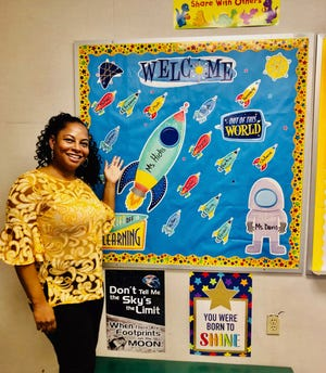 Karlotta Hicks, a first grade teacher at Winans Academy of Performing Arts, in her classroom on the first day of school 2020. She taught from her classroom via video conference. She chose an outer space theme for her classroom this year, she said, to help students get used to the idea that the pandemic has ushered in a new world.