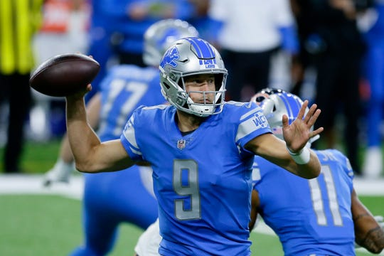 Lions quarterback Matthew Stafford throws against the Bears in the first half on Sunday, Sept. 13, 2020, at Ford Field.