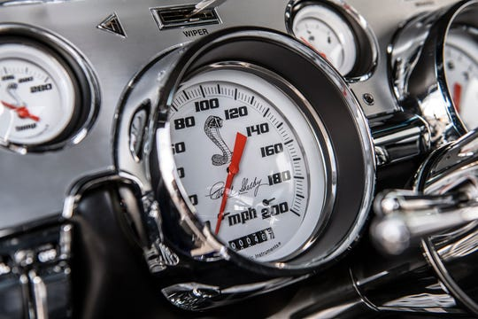 Interior: 200mph speedometer with signature Shelby white face gauges.