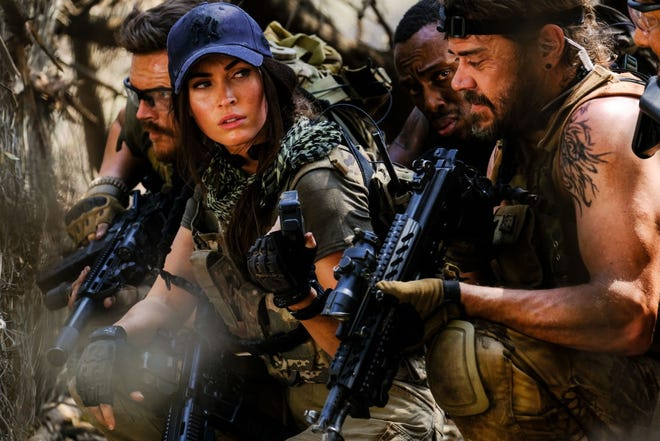 "Megan Fox stars as a mercenary leading a squad of soldiers on their mission to rescue hostages in remote part of Africa in B-list movie ""Rogue."""