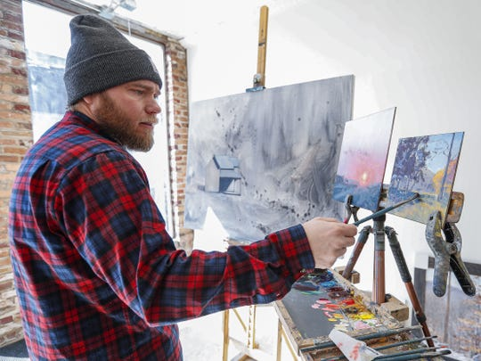 Indianapolis artist Justin Vining paints at Vining Gallery, 2620 E. 10th St., in this March 4 photo.