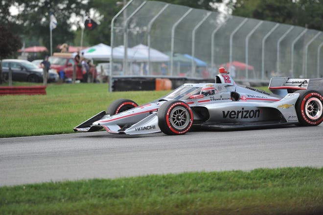 Team Penske's Will Power took the checkered flag for the first time this season when he won the first of a doubleheader during the Honda Indy 200 at Mid-Ohio on Saturday.