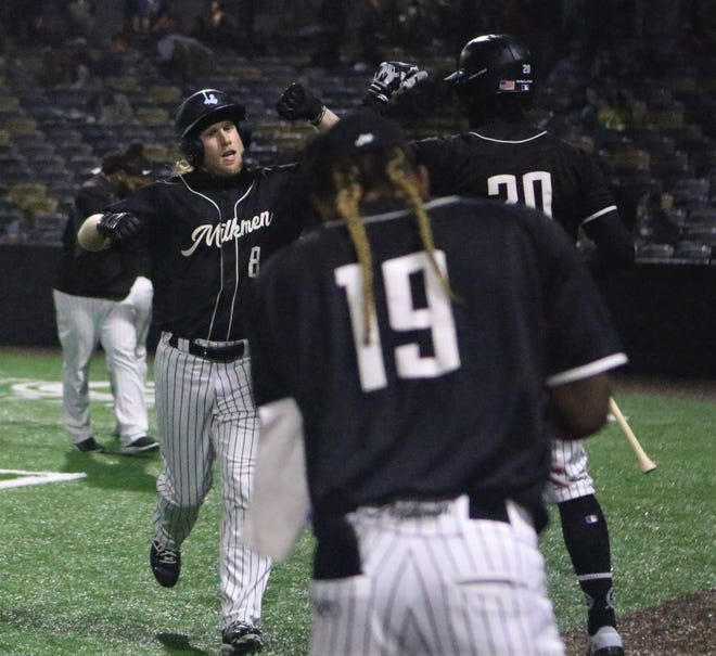 Milwaukee Milkmen outfielder Brett Vertigan (left) celebrates his home run with teammates during Game 1 of the American Association Championship Series at Franklin Field.