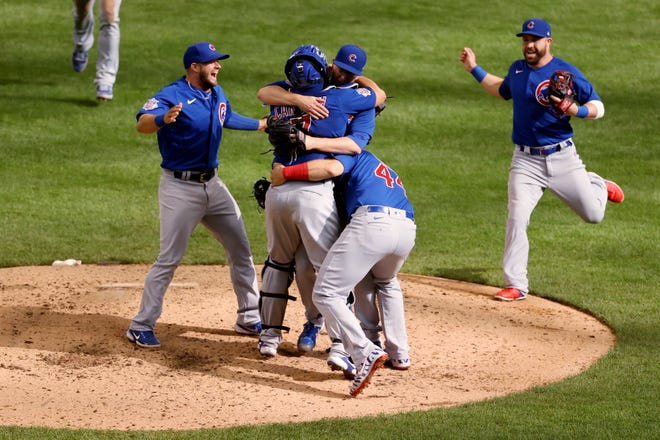 Teammates  come in to celebrate with Cubs starter Alec Mills, who threw a no-hitter Sunday.