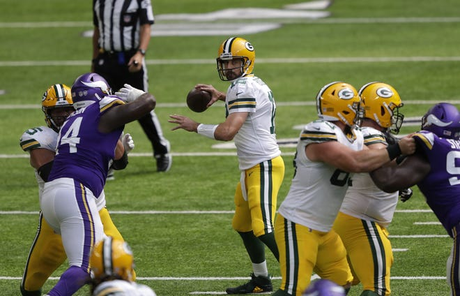Green Bay Packers' Aaron Rodgers (12) looks to pass in the first half against the Minnesota Vikings during their football game Sunday, September 13, 2020, at U.S. Bank Stadium in Minneapolis, Minn.