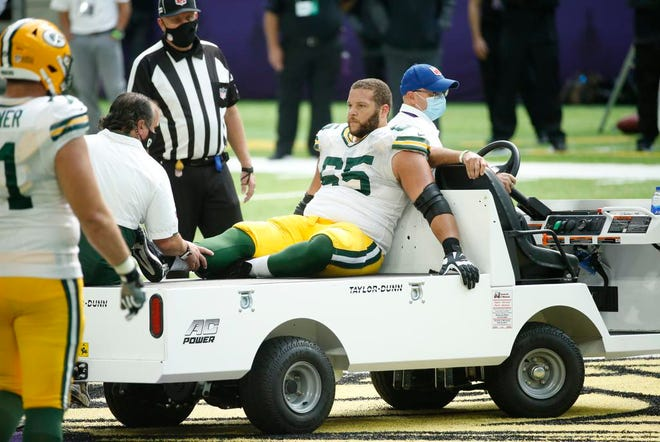 Packers guard Lane Taylor is carted off the field after getting injured during the second half against the Vikings on Sept. 13, 2020.