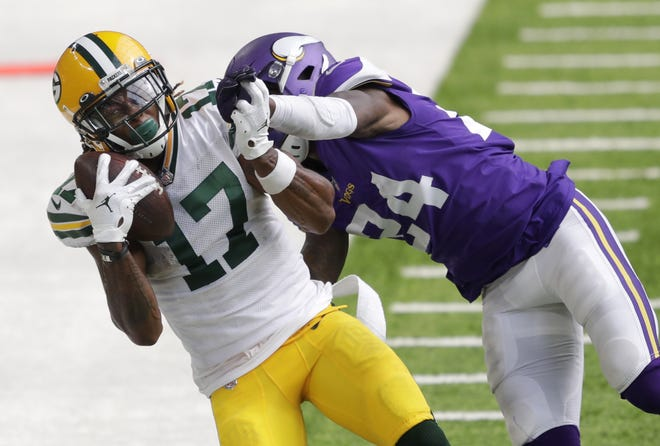 Green Bay Packers wide receiver Davante Adams (17) pulls down a long reception against Minnesota Vikings cornerback Holton Hill (24) in the fourth quarter during their football game Sunday, September 13, 2020, at U.S. Bank Stadium in Minneapolis, Minn. Green Bay won 43-34.