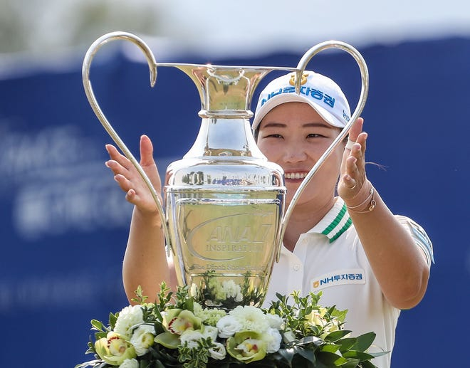 Mirim Lee picks up the trophy after winning the ANA Inspiration at Mission Hills Country Club in Rancho Mirage, September 13, 2020.