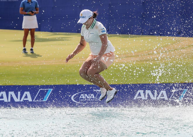Mirim Lee takes the leap into Poppie's Pond after winning the ANA Inspiration at Mission Hills Country Club in Rancho Mirage, September 13, 2020.