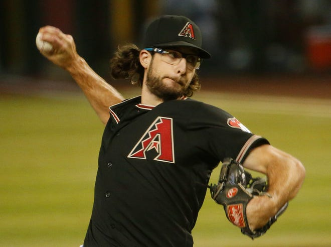 Diamondbacks' Zac Gallen (23) pitches in the first inning against the Mariners at Chase Field in Phoenix, Ariz. on Sept. 12, 2020.