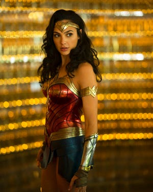 """Gal Gadot stars in """"Wonder Woman 1984."""" Following the less-than-stellar theatrical debut of Christopher Nolan's """"Tenet,"""" Warner Bros. is delaying its next big release, """"Wonder Woman 1984,"""" to Christmas."""