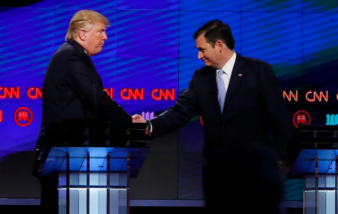 Donald Trump shakes hands with Senator Ted Cruz following the CNN Republican Presidential Debate March 10, 2016 in Miami, FL. (Rhona Wise/AFP via Getty Images)