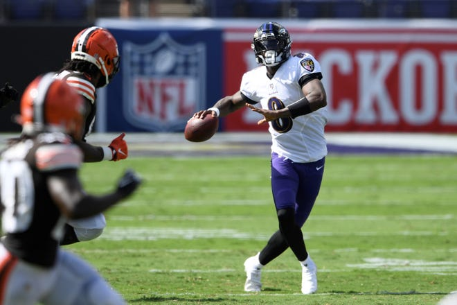 Baltimore Ravens quarterback Lamar Jackson (8) looks to pass, during the second half of an NFL football game against the Cleveland Browns, Sunday, Sept. 13, 2020, in Baltimore, MD. (AP Photo/Nick Wass)
