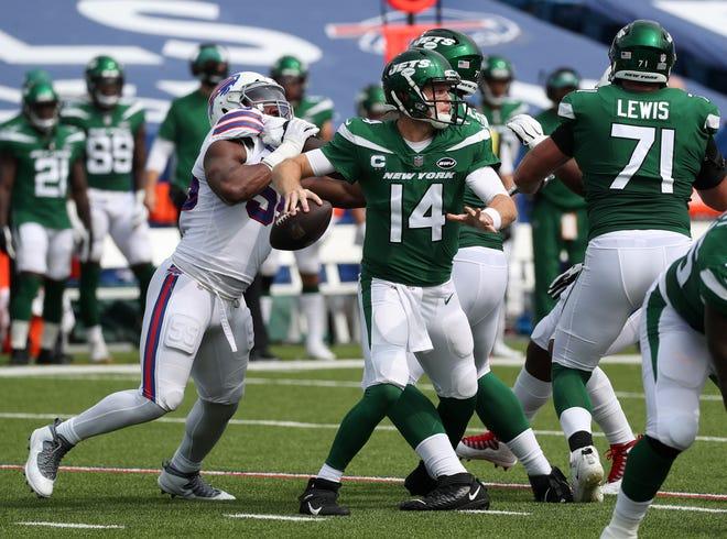Jets quarterback Sam Darnold is pressured by the Bills' Jerry Hughes.