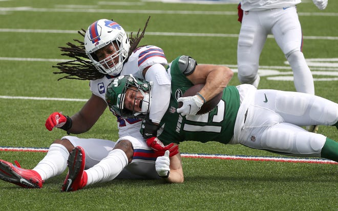 Bills linebacker Tremaine Edmunds makes a hard tackle on Jets receiver Chris Hogan in a 27-17 win Sunday.