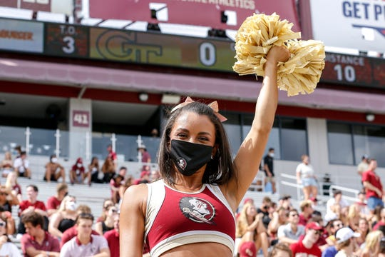 TALLAHASSEE, FL - SEPTEMBER 12: A Cheerleader from the Florida State Seminoles performs from the stands during the game against the Georgia Tech Yellow Jackets at Doak Campbell Stadium on Bobby Bowden Field on September 12, 2020 in Tallahassee, Florida. (Photo by Don Juan Moore/Character Lines)