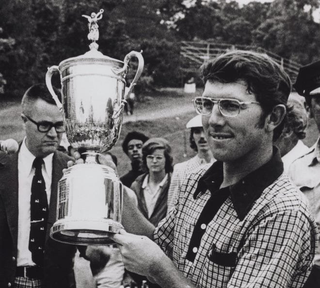 Hale Irwin holds the U.S. Open Championship Trophy in 1974 after finishing the grind with a 7-over total of 287 on the West Course at Winged Foot Golf Club.