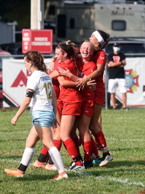 Korynn Porter is mobbed my teammates after kicking the ao-ahead goal with 52 seconds left in Rosecrans' 2-1 win against West Muskingum on Saturday at Mattingly Family Field. The Bishops improved to 2-5-0 overall.