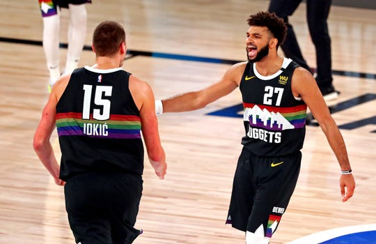 Nuggets center Nikola Jokic and guard Jamal Murray during the fourth quarter of Denver's Game 6 win.