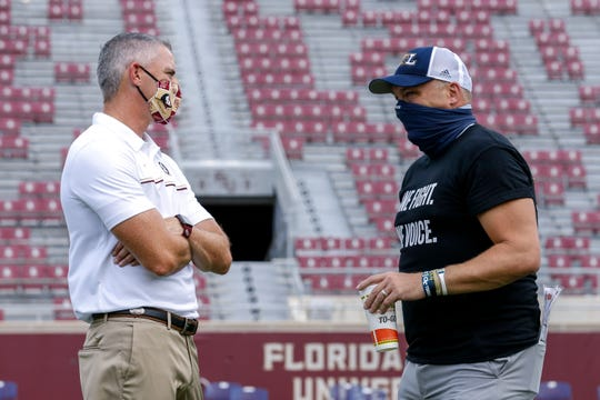 Head Coach Mike Norvell of the Florida State Seminoles talks with Head Coach Geoff Collins of the Georgia Tech Yellow Jackets before the game at Doak Campbell Stadium on Bobby Bowden Field on Sept. 12, 2020 in Tallahassee, Fla.