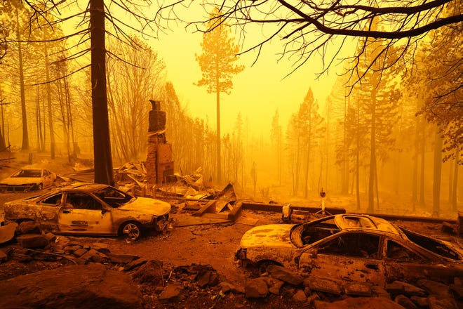 Bear Fire, in Butte, Lassen, Plumas & Yuba Counties, Calif. on Sept. 9, 2020. Remains of a house and cars along rt. 162 near Berry Creek on Wednesday after the Bear Fire swept through.