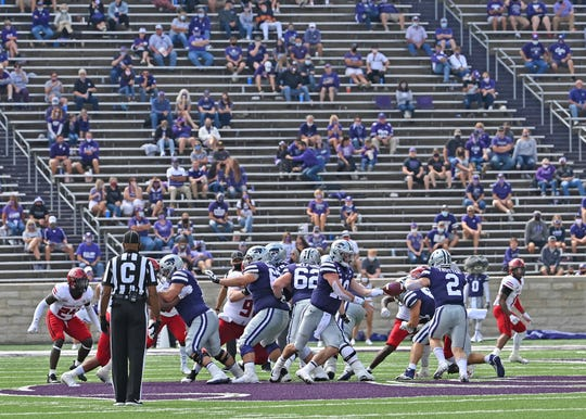 Kansas State fans watch the school play against Arkansas State during the first half at Bill Snyder Family Football Stadium on Sept. 12, 2020.