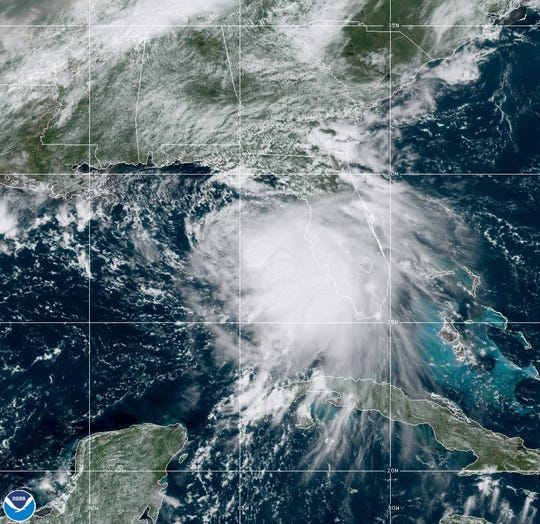 Tropical Storm Sally moves west-northwestward through the Gulf of Mexico in this satellite photo Sunday. The storm was expected to strengthen into a hurricane on Monday.