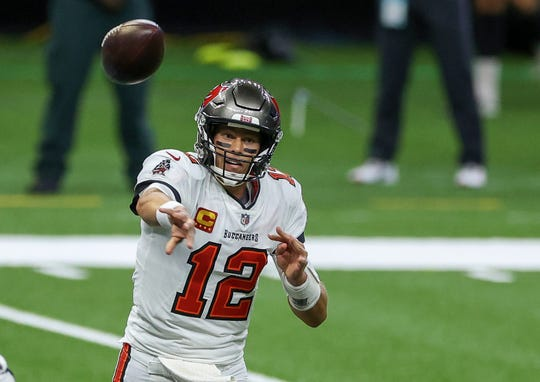 Tampa Bay Buccaneers quarterback Tom Brady (12) throws against the New Orleans Saints during the first quarter at the Mercedes-Benz Superdome.