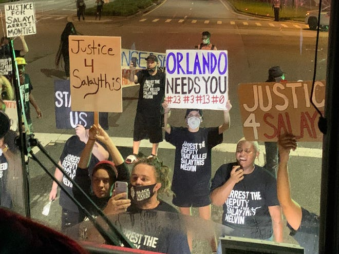 Protesters block buses outside the NBA campus at Disney World.