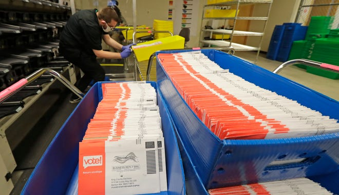 Vote-by-mail ballots are shown in sorting trays at the King County Elections headquarters in Renton, Wash., south of Seattle, Aug. 5, 2020.