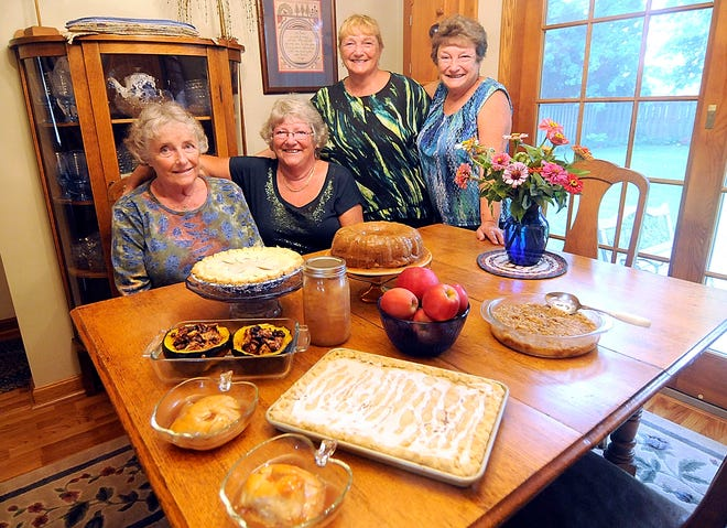 Sisters Carolyn Cooksey, Ruth Wilkerson, Barb Stauder and Jane Ruggles are shown with their desserts made with favorite apple recipes.