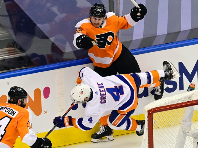 The Flyers'  Nicolas Aube-Kubel checks the Islanders' Andy Greene behind the net during Game 7.