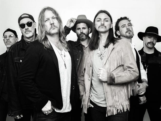 Devon Allman, front left, and the Allman Betts Band play the Starlight Drive-in in Butler. Devon is the son of the late Gregg Allman of the Allman Brothers Band.