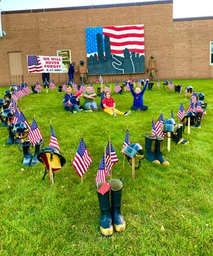 Children of local firefighters assisted with the 9/11 display. Shown are kids from the Rystad, Klawitter and Bengtson families.