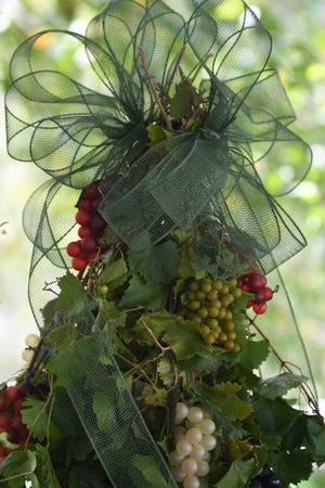 Who said Christmas trees had to be actual trees. A fun project is to create a Christmas tree using grapevines on a tomato cage.