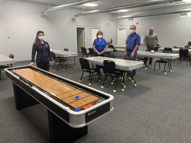 Gilcrest Center transportation director Julia Saeger, owners Annette and John Saeger, and Tom McAnallen, director of human resources, are prepared to welcome seniors back to the Doylestown facility which renovated its recreation room just before the pandemic shuttered operations.