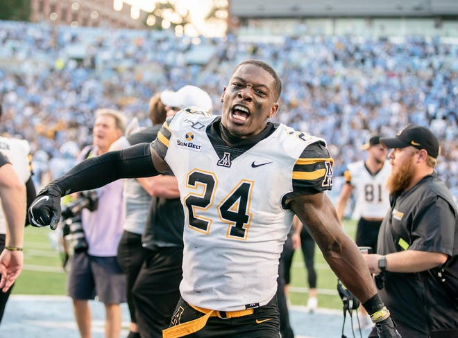 Appalachian State's Akeem Davis-Gaither celebrates during the Mountaineers' 34-31 win over North Carolina on Sept. 21, 2019 at Kenan Stadium. Davis-Gaither made three tackles and had one quarterback hit in his NFL debut with the Cincinnati Bengals on Sunday.