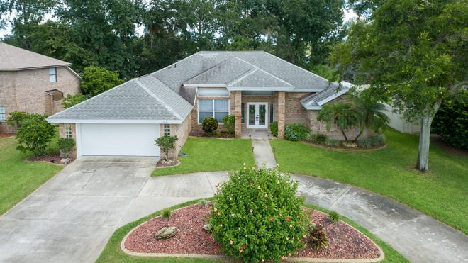 A circular driveway leads to this four-bedroom, three-three bath brick beauty in Port Orange.