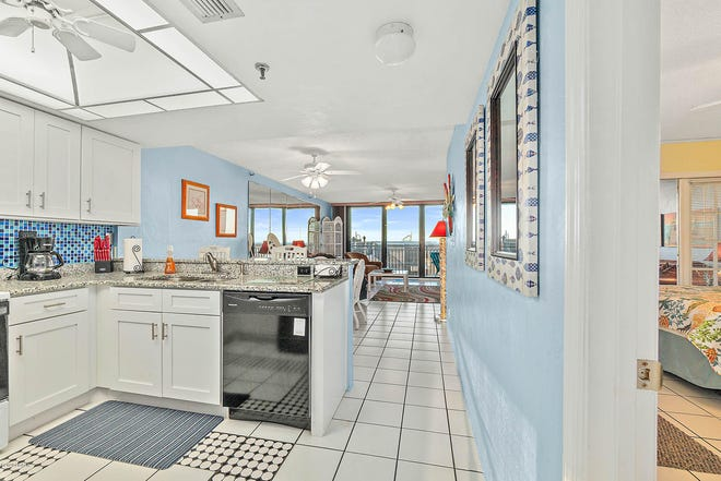 There are new granite countertops (with breakfast bar), cabinets and refrigerator in the kitchen, which overlooks the open setting, with views of the balcony and the ocean.
