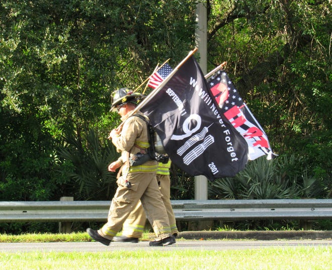 Firefighters are still moved by the tragic events of Sept. 11, 2001, during the 9/11 Memorial Walk hosted by the Ormond Beach Fire Department at Wadsworth Park in Flagler Beach on Friday.