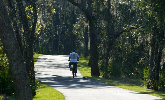 A cyclist on the Volusia County Spring to Spring Trail,near DeLand. Using ECHO tax revenue, Volusia County was able to put $1 million annually into building trails.