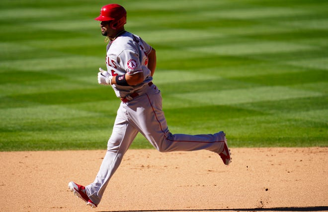 Fort Osage graduate Albert Pujols circles the bases after tying Willie Mays for fifth all time with his 660th career home run in the Los Angeles Angels' 5-3 win over the Colorado Rockies Sunday in Denver.